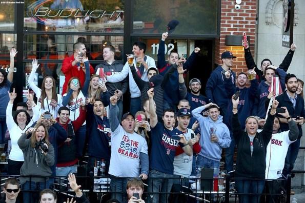 """Fans cheer along Boylston Street during the Rolling Rally World Series Championship Parade through downtown Boston, Massachusetts Saturday, November 2, 2013."""