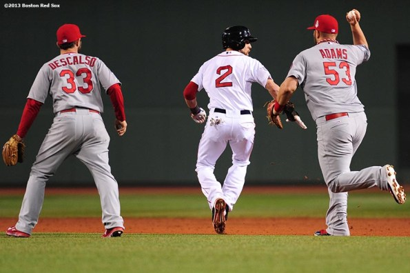 """""""Boston Red Sox center fielder Jacoby Ellsbury gets caught in a run down during the eighth inning of game six of the 2013 World Series against the St. Louis Cardinals Wednesday, October 30, 2013 at Fenway Park in Boston, Massachusetts."""""""