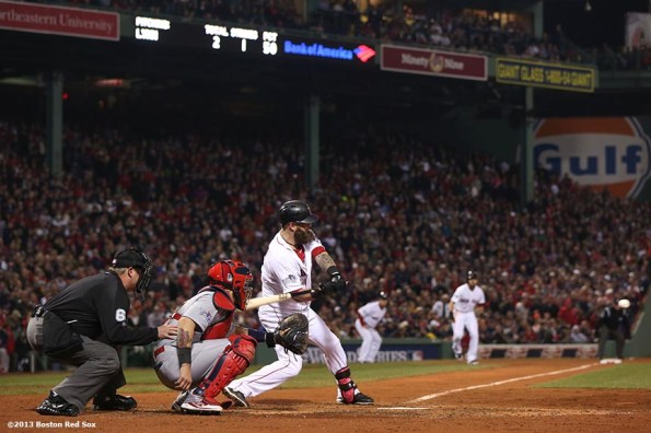 """""""Boston Red Sox first baseman Mike Napoli hits an RBI single during the fourth inning of game six of the 2013 World Series against the St. Louis Cardinals Wednesday, October 30, 2013 at Fenway Park in Boston, Massachusetts."""""""