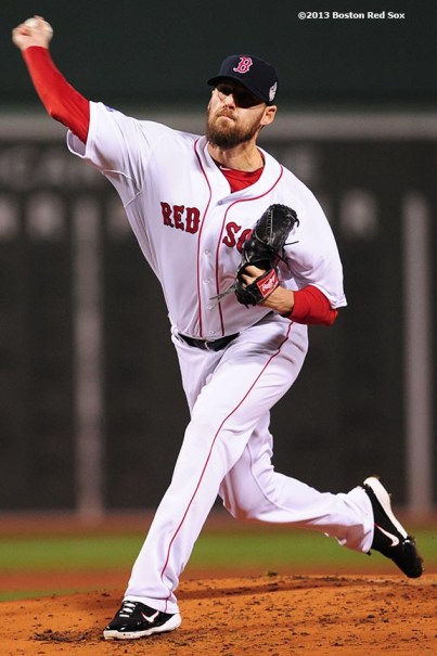 """""""Boston Red Sox pitcher John Lackey delivers during the first inning of game six of the 2013 World Series against the St. Louis Cardinals Wednesday, October 30, 2013 at Fenway Park in Boston, Massachusetts."""""""