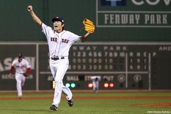 """""""Boston Red Sox pitcher Koji Uehara reacts after recording the final out to defeat the St. Louis Cardinals 6-1 to win the 2013 World Series Wednesday, October 30, 2013 at Fenway Park in Boston, Massachusetts."""""""