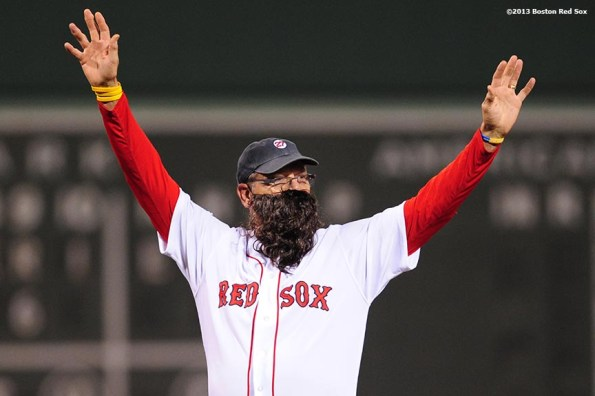 """""""Former Boston Red Sox player Carlton Fisk wears a beard while throwing out the ceremonial first pitch during a pre-game ceremony before game six of the 2013 World Series between the Boston Red Sox and the St. Louis Cardinals Wednesday, October 30, 2013 at Fenway Park in Boston, Massachusetts."""""""