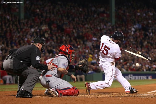 """""""Boston Red Sox second baseman Dustin Pedroia breaks his bat during the third inning of game six of the 2013 World Series against the St. Louis Cardinals Wednesday, October 30, 2013 at Fenway Park in Boston, Massachusetts."""""""