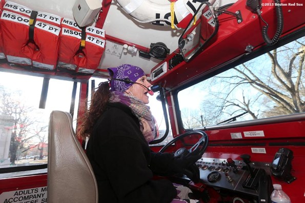 """""""Boston Duck Boat driver 'Flo' drives Boston Red Sox players and coaches through Boston, Massachusetts Thursday, December 12, 2013 as part of the Red Sox Holiday Caravan to various locations throughout Boston."""""""
