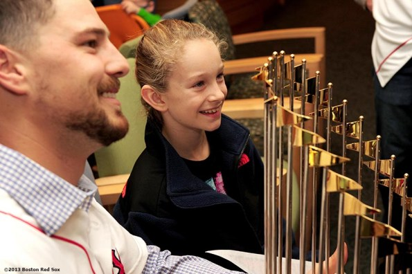"""""""Boston Red Sox catcher Ryan Lavarnway poses with a patient and the World Series trophy during a visit to The Jimmy Fund at Dana-Farber Cancer Institute in Boston, Massachusetts Friday, December 13, 2013 as part of the Red Sox Holiday Caravan to various locations throughout Boston."""""""