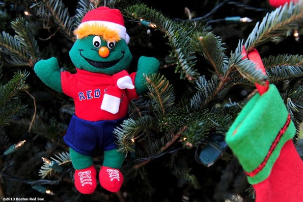"""""""A Red Sox themed christmas ornament is shown during the annual Christmas at Fenway celebration Saturday, December 14, 2013, which featured speaking appearances and autograph sessions with players and coaches, holiday themed attractions and decorations, and opportunities for fans to purchase tickets for the 2014 season."""""""