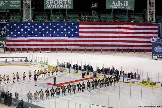 """""""Starting lineups are introduced before a game between Boston College and Notre Dame at Frozen Fenway Saturday, January 4, 2014 at Fenway Park in Boston, Massachusetts."""""""