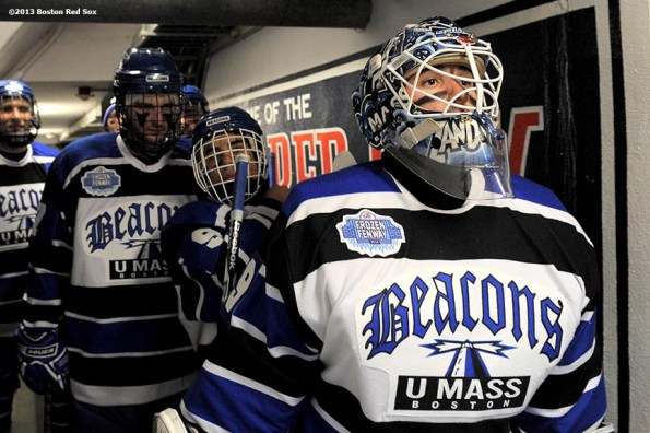 """""""University of Massachusetts players wait in the Red Sox dugout tunnel before a game against Salem State at Frozen Fenway Tuesday, January 7, 2014 at Fenway Park in Boston, Massachusetts."""""""