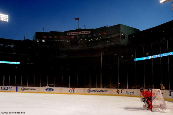 """""""The Salem State goalie waits in the net during a game against the University of Massachusetts at Frozen Fenway Tuesday, January 7, 2014 at Fenway Park in Boston, Massachusetts."""""""