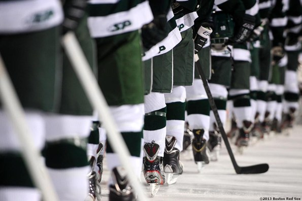 """""""Babson College players line up on the ice before a game against Norwich University at Frozen Fenway Thursday, January 9, 2014 at Fenway Park in Boston, Massachusetts."""""""