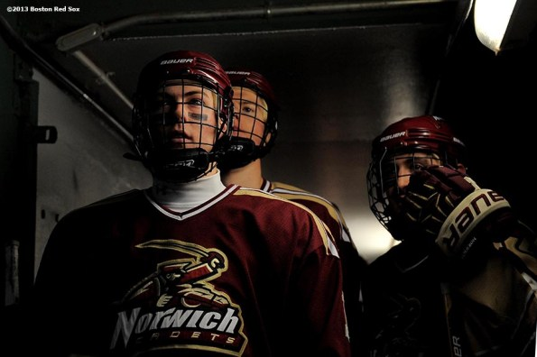 """""""Norwich University players wait in the dugout tunnel before a game against Babson College at Frozen Fenway Thursday, January 9, 2014 at Fenway Park in Boston, Massachusetts."""""""