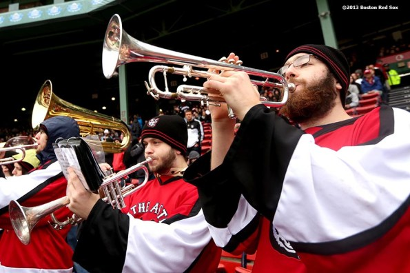 """""""The Northeastern University marching band plays during a game against University of Massachusetts Lowell at Frozen Fenway Saturday, January 11, 2014 at Fenway Park in Boston, Massachusetts."""""""