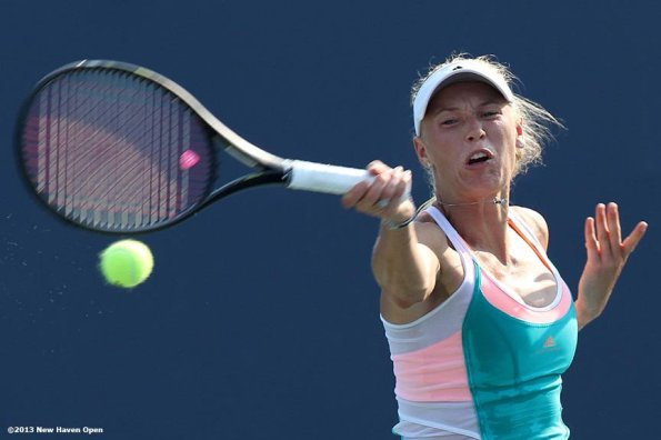 """""""Caroline Wozniacki connects on a forehand on Day 6 of the New Haven Open at Yale University in New Haven, Connecticut Wednesday, August 21, 2013."""""""