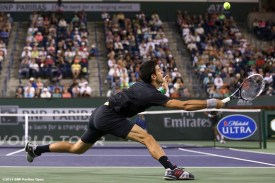 """""""Novak Djokovic reaches for a return from Victor Hanescu in a second round match at the 2014 BNP Paribas Open in Indian Wells, California Sunday, March 9, 2014."""""""