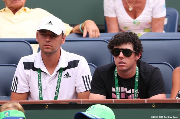 """""""Golfer Rory McIlroy watches a match between Caroline Wozniacki and Jelena Jankovic at the Indian Wells Tennis Garden Tuesday, March 11, 2014 in Indian Wells, California."""""""