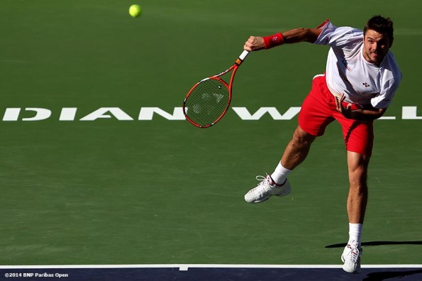 """""""Stan Wawrinka serves to Kevin Anderson during the BNP Paribas Open Wednesday, March 12, 2014 in Indian Wells, California."""""""