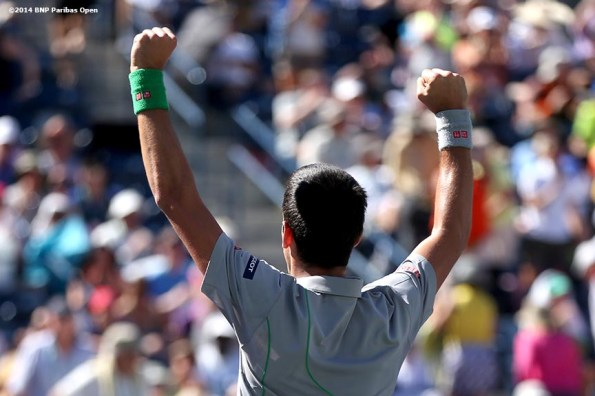 """""""Novak Djokovic reacts after defeating Julien Benneteau in the quarterfinal of the 2014 BNP Paribas Open Friday, March 14, 2014 in Indian Wells, California."""""""