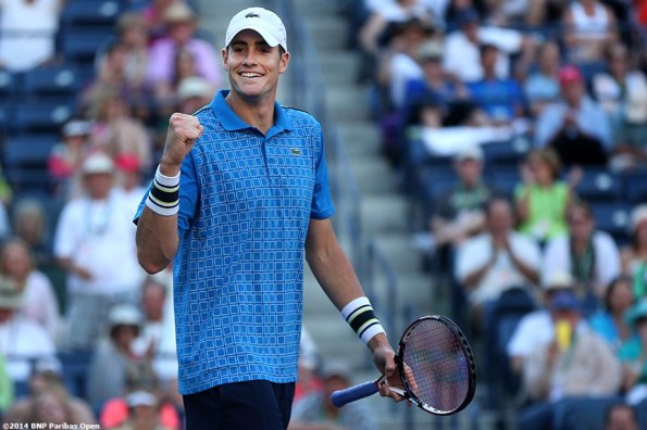 """""""John Isner reacts after defeating Ernests Gulbis in the quarterfinals of the 2014 BNP Paribas Open Friday, March 14, 2014 in Indian Wells, California."""""""