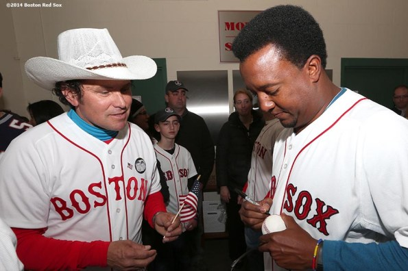 """""""Boston Marathon hero Carlos Arredondo gets an autograph from former Boston Red Sox pitcher Pedro Martinez during a meet and greet before the Boston Red Sox 2014 home opening day and World Series ring ceremony Friday, April 4, 2014 at Fenway Park in Boston, Massachusetts."""""""