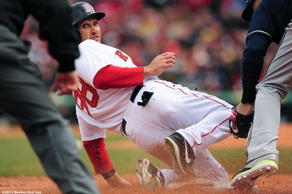 """""""Boston Red Sox center fielder Grady Sizemore slides as he steals third base during the second inning of the 2014 home opener against the Milwaukee Brewers Friday, April 4, 2014 at Fenway Park in Boston, Massachusetts."""""""