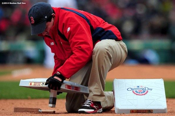 """""""A grounds crew member changes bases during the Boston Red Sox 2014 home opener Friday, April 4, 2014 at Fenway Park in Boston, Massachusetts."""""""