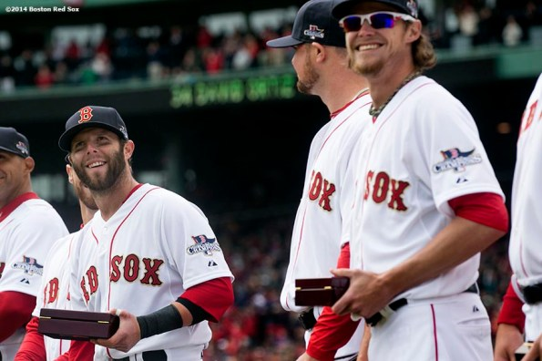 """""""Boston Red Sox second baseman Dustin Pedroia receives his ring during the World Series ring ceremony at the 2014 season home opener Friday, April 4, 2014 at Fenway Park in Boston, Massachusetts."""""""