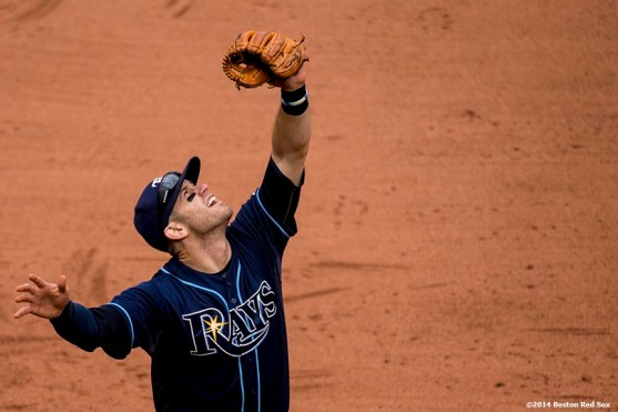 """""""Tampa Bay Rays third baseman Evan Longoria catches a fly ball during the eighth inning of the first game of a day-night double header against the Boston Red Sox Thursday, May 1, 2014 at Fenway Park in Boston, Massachusetts."""""""