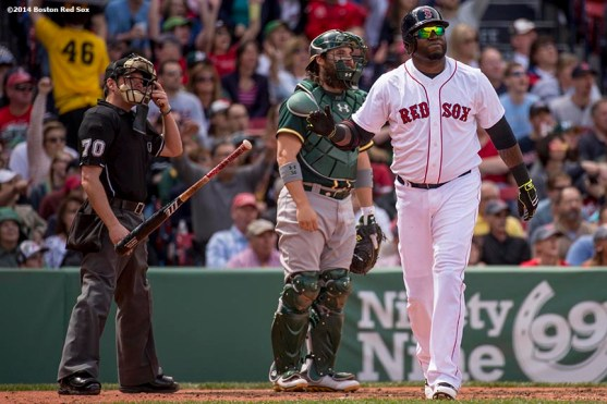 """""""Boston Red Sox designated hitter David Ortiz hits a solo home run during the third inning of a game against the Oakland Athletics Saturday, May 4, 2014 at Fenway Park in Boston, Massachusetts."""""""