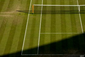 """""""A shadow falls across the grass on No. 1 Court at the All England Lawn and Tennis Club in London, England Friday, June 27, 2014 during the 2014 Championships Wimbledon."""""""