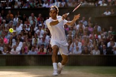 """""""Roger Federer hits a backhand during the gentlemen's singles final against Novak DJokovic at the All England Lawn and Tennis Club in London, England Sunday, July 6, 2014 during the 2014 Championships Wimbledon."""""""