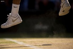 """""""Roger Federer serves during the gentlemen's singles final against Novak DJokovic at the All England Lawn and Tennis Club in London, England Sunday, July 6, 2014 during the 2014 Championships Wimbledon."""""""