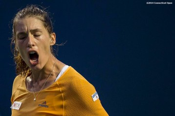 """""""Andrea Petkovic reacts during a match against Kirsten Flipkens on day six of the 2014 Connecticut Open at the Yale University Tennis Center in New Haven, Connecticut Tuesday, August 19, 2014."""""""