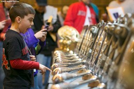 """""""A fan looks at the silver slugger awards during the Red Sox Winter Weekend at Foxwoods Resort and Casino in Ledyard, Connecticut Saturday, January 24, 2015."""""""