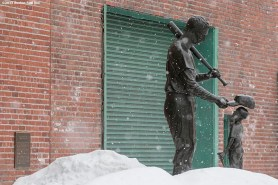 """""""The Ted Williams statue is shown as snow falls during Boston Red Sox truck day Thursday, February 12, 2015 at Fenway Park in Boston, Massachusetts."""""""