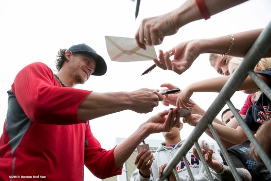 """""""Boston Red Sox pitcher Clay Buchholz signs autographs for fans during a team workout at JetBlue Park in Fort Myers, Florida Thursday, February 26, 2015."""""""