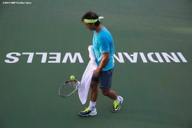 """""""Rafael Nadal takes a break during a practice session at the Indian Wells Tennis Garden in Indian Wells, California Monday, March 9, 2015."""""""