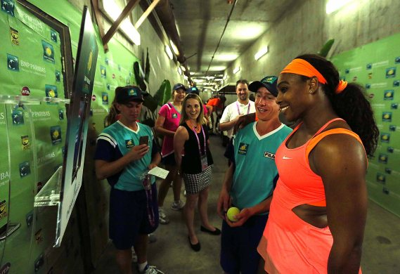 """""""Serena Williams poses with a ball kid for the Twitter mirror following her win against Monica Niculescu at Stadium 1 at the Indian Wells Tennis Garden in Indian Wells, California on Friday, March 13, 2015."""""""