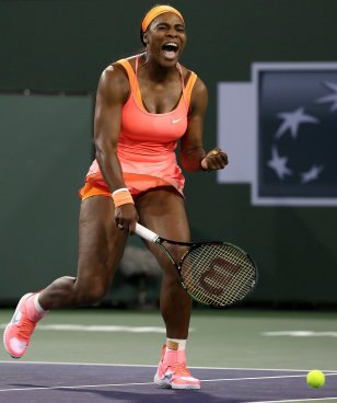 """""""Serena Williams in action against Monica Niculescu during their match at Stadium 1 at the Indian Wells Tennis Garden in Indian Wells, California on Friday, March 13, 2015."""""""