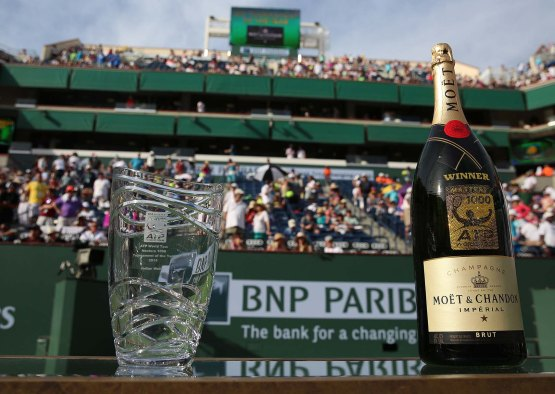 """""""BNP Paribas Open CEO, Raymond Moore, ATP President, Chris Kermode, and tournament director, Steve Simon, present an award for the ATP Tournament of the Year at the Indian Wells Tennis Garden in Indian Wells, California on Sunday, March 15, 2015."""""""