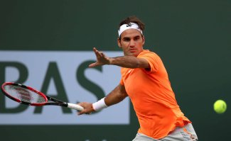 """""""Roger Federer defeats Diego Schwartzman in a second round match on Stadium 1 at the Indian Wells Tennis Garden in Indian Wells, California on Sunday, March 15, 2015."""""""