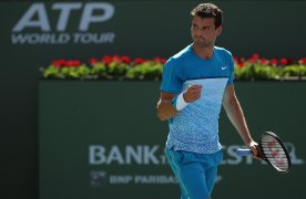 """""""Grigor Dimitrov in action against Nick Kyrgios during their match at stadium 1 at the Indian Wells Tennis Garden in Indian Wells, California on Sunday, March 15, 2015."""""""