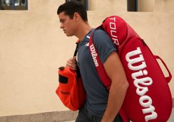 """""""Milos Raonic walks toward stadium one before a match against Tommy Robredo at the Indian Wells Tennis Garden in Indian Wells, California Wednesday, March 18, 2015."""""""