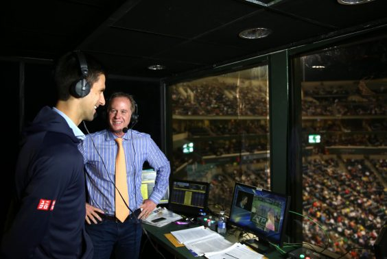 """""""Novak Djokovic visits the ESPN booth with Chris Evert and Patrick McEnroe during the 2015 BNP Paribas Open in Indian Wells, California on Thursday, March 19, 2015."""""""