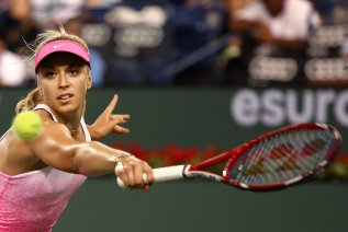 """""""Sabine Lisicki during a women's semi-final match against Jelena Jankovic on day twelve at the Indian Wells Tennis Garden in Indian Wells, California Friday, March 20, 2015."""""""