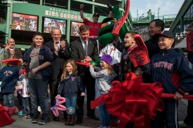 """""""Boston Mayor Marty Walsh, Boston Red Sox President & CEO Larry Lucchino, Chairman Tom Werner, and local kids participate in a ribbon cutting ceremony for the opening of a newly constructed Gate K Kids Concourse during a walk through of Fenway Park in Boston, Massachusetts Monday, April 6, 2015."""""""