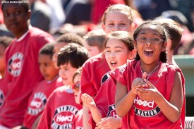 """""""Kids react as they take the field with players during a pre-game ceremony before the Boston Red Sox 2015 home opener against the Washington Nationals Monday, April 13, 2015 at Fenway Park in Boston, Massachusetts."""""""