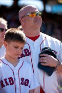 """""""Fans look on during a moment of silence at 2:49 PM recognizing the anniversary of the Boston Marathon bombings during a game between the Boston Red Sox and the Washington Nationals at Fenway Park in Boston, Massachusetts Wednesday, April 15, 2015."""""""