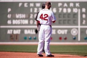 """""""Boston Red Sox second baseman Dustin Pedroia pauses for a moment of silence at 2:49 PM recognizing the anniversary of the Boston Marathon bombings during a game between the Boston Red Sox and the Washington Nationals at Fenway Park in Boston, Massachusetts Wednesday, April 15, 2015."""""""