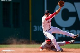 """""""Boston Red Sox shortstop Xander Bogaerts turns a double play during the sixth inning of a game against the Washington Nationals at Fenway Park in Boston, Massachusetts Wednesday, April 15, 2015."""""""