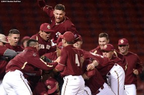 """""""Members of the Boston College baseball team celebrate after defeating University of Massachusetts to win the Baseball Beanpot Championship game at Fenway Park in Boston, Massachusetts Wednesday, April 22, 2015."""""""